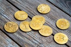 Gold Bitcoin money on wooden table. Electronic crypto currency. Business concept stock images