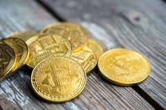 Gold Bitcoin money on wooden table. Electronic crypto currency. Business concept royalty free stock photos