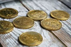 Gold Bitcoin money on wooden table. Electronic crypto currency. Business concept stock photo