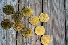 Gold Bitcoin money on wooden table. Electronic crypto currency. Business concept royalty free stock image