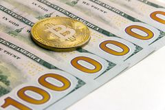 What cryptocurrency exchange rate. Five hundred dollar bills. One million dolars.Gold bitcoin next to US banknotes. White backgrou royalty free stock photos