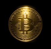 Gold bitcoin physical isolated on black background.  Royalty Free Stock Image