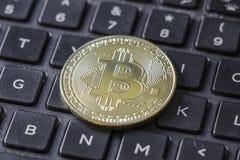 Gold Bitcoin Token On Keyboard.  Royalty Free Stock Photo