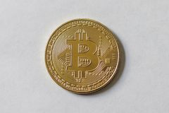 A Large Gold Bitcoin Token. A gold Bitcoin token white background large Royalty Free Stock Image