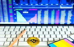 Gold bitcoin and trading chart background. Virtual currency concept Royalty Free Stock Image