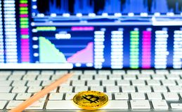 Gold bitcoin and trading chart background. Virtual currency concept Royalty Free Stock Photo