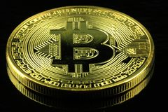 Gold Bitcoins cryptocurrency money on a black background Stock Photo