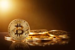 Gold bitcoins. On a yellow background stock images