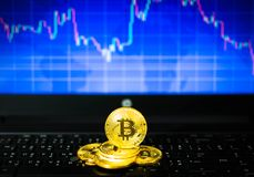 Gold bitcoins on key board and BTC trading chart in background, Financial concept. Gold bitcoins on key board and BTC trading chart in background, Financial Royalty Free Stock Photos