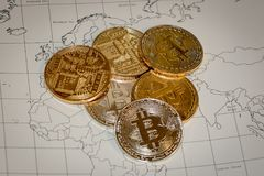 Gold Bitcoins On Map Stock Photography