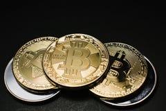Bitcoin. Gold Bitcoins on a one hundred dollar bill close up. Gold Bitcoins on a one hundred dollar bill close up Stock Photos