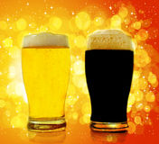 Gold and black beer Stock Images