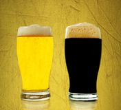 Gold and black beer Royalty Free Stock Image