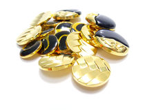 Gold and black buttons Stock Photography