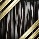 Gold on black curtain Stock Images