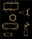 Gold and black frame element set. Gold floral frame elements and emblems in set on a black background Stock Photos