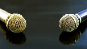 Gold and black Microphones on black background. Concept about music and song Royalty Free Stock Image