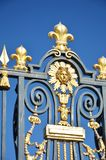 Gold and Black palace gates in detail Stock Image