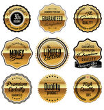 Gold and black premium Quality Labels Stock Images