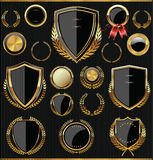 Gold and black shields, laurels and medals collection. Golden shields, laurels and medals retro collection Royalty Free Stock Photo