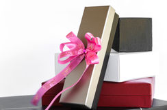Gold black white and red gift box with pink ribbon bow , isolat Stock Image