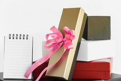 Gold black white and red gift box with pink ribbon bow Royalty Free Stock Photo