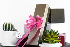 Gold black white and red gift box with pink ribbon bow Stock Image