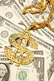 Gold bling on money Royalty Free Stock Photography