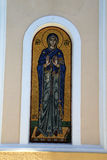 Gold and blue mosaic of saint on Greek Island. Gold and blue mosaic set in niche of church wall on Greek Island of Psirimos royalty free stock images