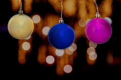 Gold, blue, purple ball christmas concept with blurred light bok Royalty Free Stock Photo