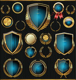 Gold and blue shields, laurels and medals collection. Golden shields, laurels and medals retro collection Royalty Free Stock Image