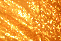 Gold blurred light Stock Images