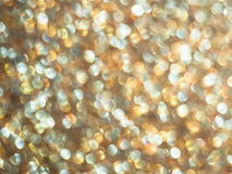 Gold bokeh abstract background defocused lights, texture wallpaper Stock Images