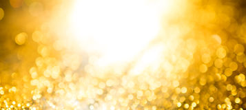 gold bokeh abstract background defocused lights wide fan page pa Stock Photos
