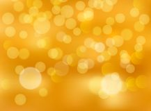 Gold bokeh abstract festive background. Golden christmas light shine bright holiday magic decoration.  Royalty Free Stock Photo