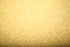 Gold bokeh background. Abstract gold bokeh background of glowing lights, party, holiday, christmas Stock Photos