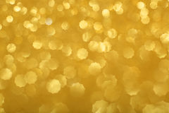 Gold bokeh background Stock Images