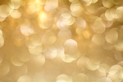 Gold Bokeh Background. The background with boke. Abstract texture. Color circles. Blurred. Royalty Free Stock Images