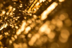 Gold bokeh background with ultra soft round elements and sunny light expression. Stock Image
