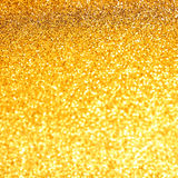Gold bokeh background. Gold bokeh yellow shiny background Royalty Free Stock Photography