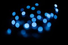 Blue bokeh circles on a dark background, abstraction, background. Gold bokeh on a dark background, abstraction, background stock images