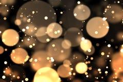 Gold-bokeh in der Dunkelheit Stockfotografie