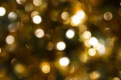 Gold bokeh effect. Abstraction of gold bokeh circles Royalty Free Stock Images