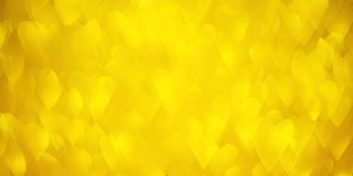 Gold bokeh hearts Background with Bright golden glitter Lights for Valentine`s Day or Women day, 8 march. Defocused shine texture royalty free stock photos