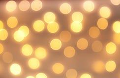 Gold-bokeh Licht-Weinlesehintergrund Stockbild