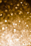 Gold Bokeh Light. Gold blurred light.  Useful as Christmas background or greeting card Royalty Free Stock Image
