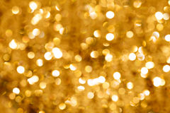 Gold Bokeh Light. Gold blurred light.  Useful as Christmas background or greeting card Royalty Free Stock Photos