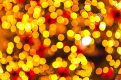 Gold Bokeh Light. Gold abstract background, blurred sun light - bokeh. Orange, brown and yellow dots Stock Photography