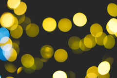 Gold bokeh of light. Gold bokeh of light on black background Royalty Free Stock Photography