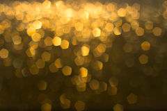 Gold bokeh lights. Abstract background Stock Photo